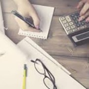 person at desk calculating bankruptcy atlanta