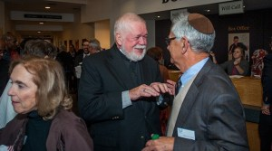 Msgr. Henry Gracz, pastor of the Shrine of the Immaculate Conception, Atlanta, left, converses with Rabbi Scott E. Colbert, senior rabbi of Temple Emanu-El, Atlanta, at the reception before the Nostra Aetate Jubilee celebration Oct. 28. The reception included an art and history exhibition. Rabbi Colbert was a co-chair of the event, and Msgr. Gracz served on the steering committee. Photo By Thomas Spink