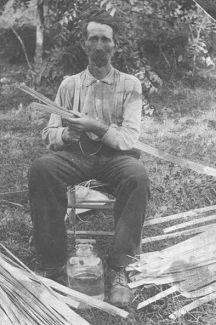 Harvey Walter Whitfield making baskets