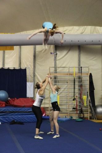 Three Cirque du Soleil gymnasts in training