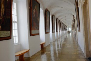 One of the many long interior hallways; the walls are lined with portraits of assorted Habsburgs.