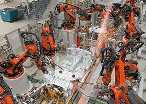Robots and humans at work in the plant.