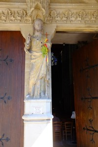 Statue of Christ holding a bunch of grapes along with a cross...