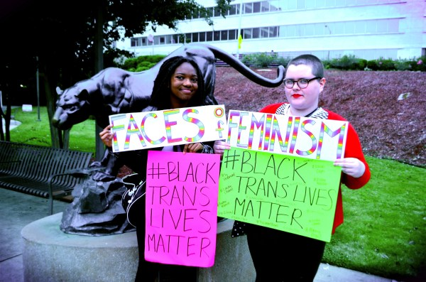 Representatives from Faces of Feminism, Vee McConnell (left) and Tiffani Carroll, show their support for #BlackTransLivesMatter.  Photos by: Justin Clay
