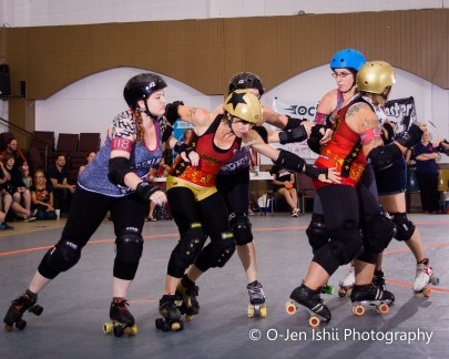 Hate (gold helmet with star), a jammer, tries to get through the blockers. Photos Submitted | O-Jen IShii