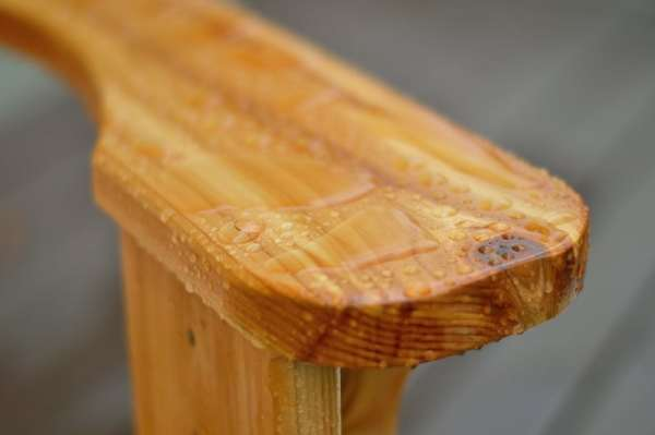 Urethane finish repels water beads on  wood
