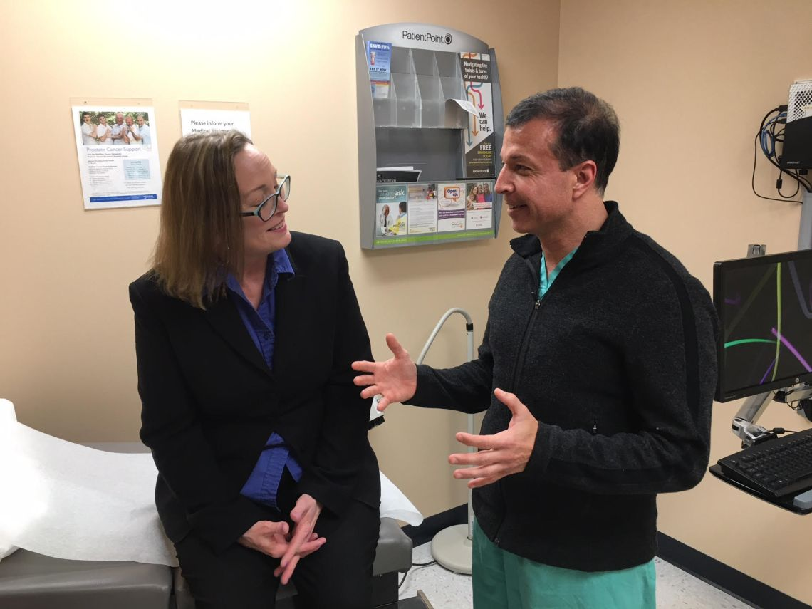 Dr. Symbas with Patient