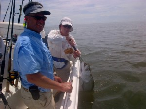 Bill Archer of Tiger, Ga. holds his first tarpon that he caught on Friday while fishing with Capt. Tim Barrett (in the foreground) from Richmond Hill, Ga.