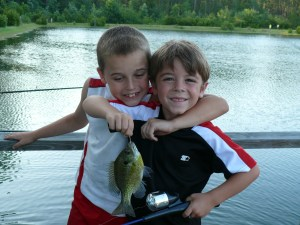 Second Baptist Church kids went fishing Tuesday evening at a Waycross pond and whacked the bluegills. Calob caught this nice bluegill and Skylar congratulated him with a choke hold.