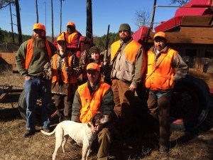 Successful youth hunters Chad Shelton of Thomasville accompanied by his father Chris and Ethan Canaday of Loganville accompanied by his father Craig proudly display their spoils from their first wild bobwhite quail hunt.  The boys enjoyed a successful BQI youth hunt at Whitehall Plantation graciously hosted by owner Tom Bradbury (not pictured) and guided by plantation wildlife manager Jason Armstrong (kneeling with trusted English pointer 'Liz').