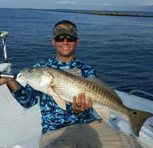 Jesse Ivey caught and released this oversized redfish over the holiday weekend while fishing the St Marys Jetties (photo courtesy of Justin Bythwood)