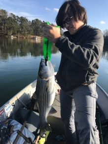Friend of Academy Jack catching his first striper!