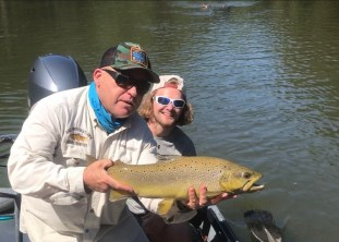 Fishing Guide Chris Scalley shows off a nice Brown Trout