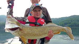 Young angler with an 8 pound Lake Burton walleye.