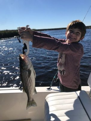 Cason (shown here) and brother Michael had a blast last weekend catching striped bass on the lower St. Marys River with their dad Brandon. Their pair of stripers ate live shrimp under a float.