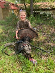 young girl with first turkey harvest