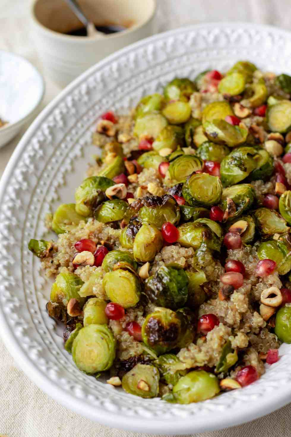 Maple Roasted Sprout Salad with Quinoa, Hazelnuts, Apple, Pomegranate & Balsamic Reduction - Vegan, GF & Healthy! Georgie Eats