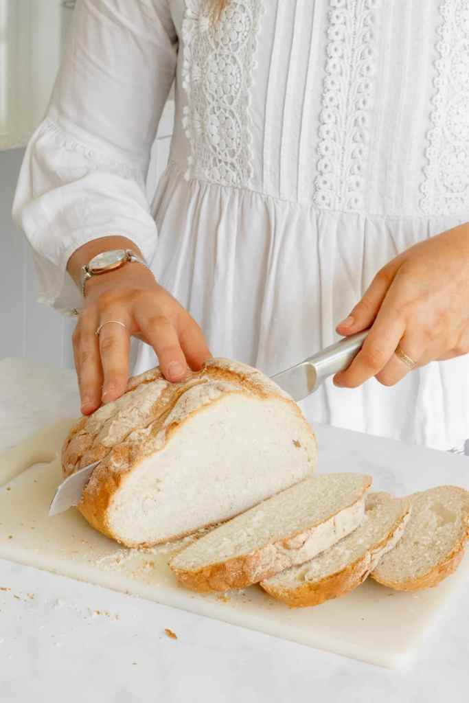 Cutting the crusty sourdough.