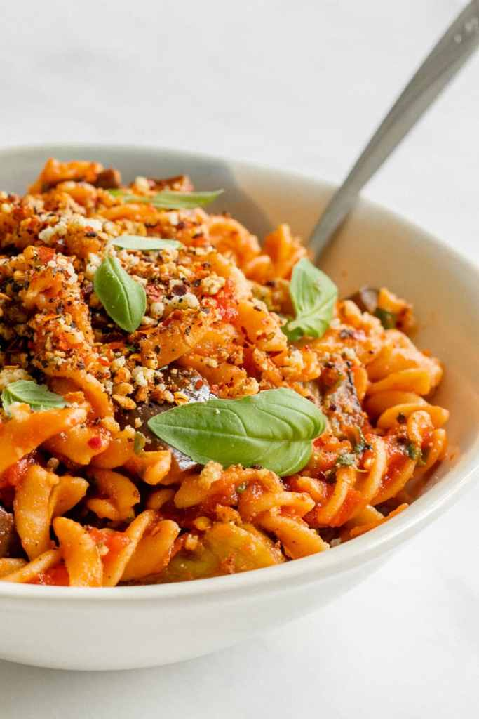 A bowl of Pasta alla Norma Topped With Crunchy Almond Crumb - Vegan, GF & Healthy! Georgie Eats.