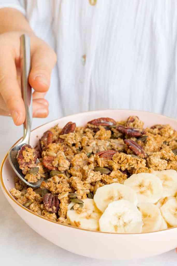 Eating a spoonful of Maple Sea Salt Granola - Vegan, GF & Healthy! Georgie Eats.