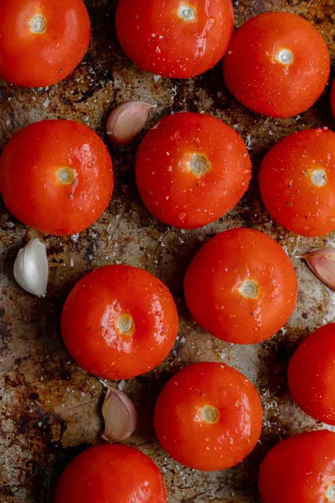 Tomatoes on a baking tray.