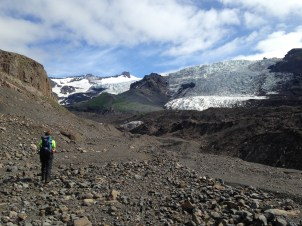 This is Chris as we head towards Virkisjokull glacier, over the rocky moraines and the black icy snout of the glacier to collect ash samples.