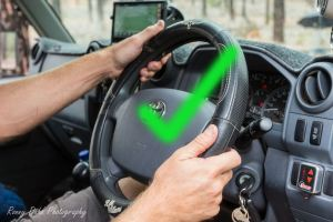 hands-placed-correctly-on-the-steering-wheel