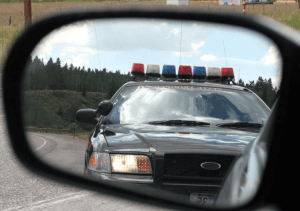 police-vehicle-in-the-mirror