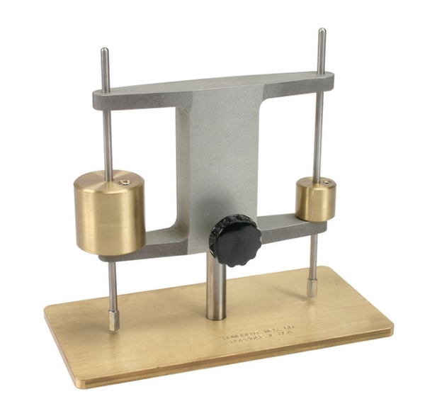 The Gillmore apparatus is used to determine the setting time of cement.