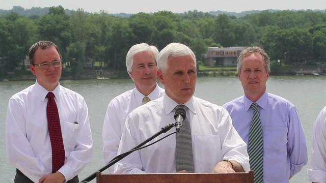 "Gov. Pence marks start of Indiana-Kentucky bridge: Indiana Gov. Mike Pence said, ""Now we're rolling our sleeves up and ... we're going to get this East End Bridge done."" He was with state, local and federal leaders in Utica, Ind., on May 29, 2013"