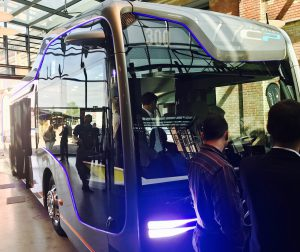 The autonomous bus shown with people in front and some inside