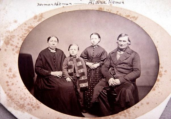 Marie & Joachim Niemann with children Herman (b. 1864) & Alvina (b. 1861). Likely 1870-71.
