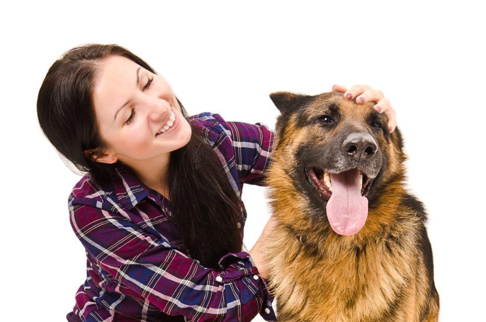 Woman Petting German Shepherd