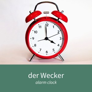 "Image showing an alarm clock and the caption ""der Wecker - alarm clock"""