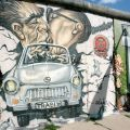 Trabi through wall Mural East Side Gallery Berlin