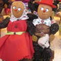 prune couple at a Christmas market