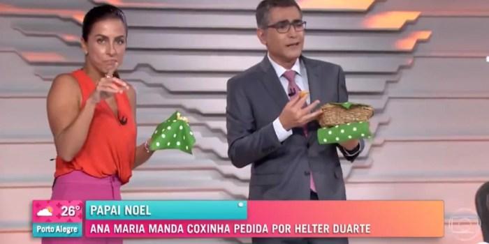 Carol Barcellos e Helter Duarte comem coxinha no estúdio do Bom Dia Brasil (Foto: Reprodução/Globo)