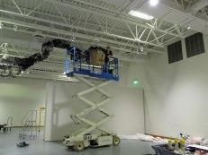 wide view of Artist Gerri Sayler working on Terra Ignis art installation at the Nicolaysen Art Museum