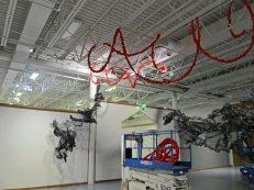 Using lift for Terra Ignis art installation by Gerri Sayler at Nicolaysen Art Museum