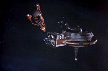 Thunderbird 3 prepares to dock with Thunderbird 5