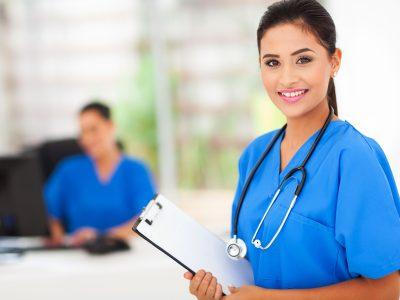 intern nurse holding a clipboard