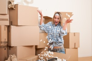Moving house: Young woman having fun