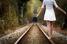 Girl Barefoot On Railroad Tracks