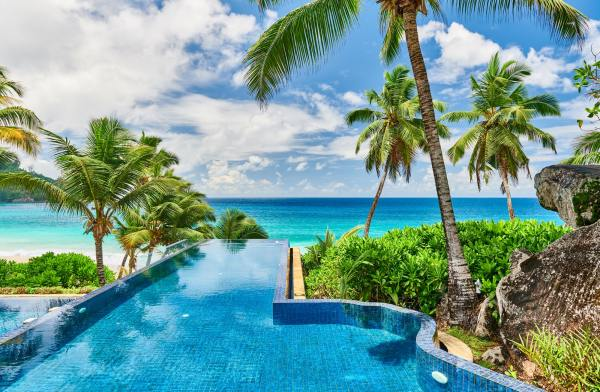 Beach with resort swimming pool at Seychelles
