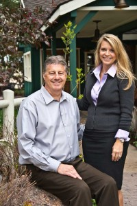 Owners Phil and Emma Goddard in front of the Inn.