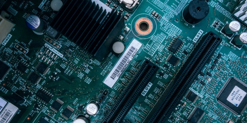 4 myths of iiot industry 4 header image circuit board green solder mask buzzer integrated circuits surface mount components freepoint technologies