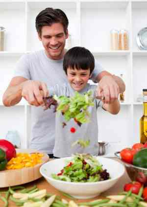 dad and boy making salad