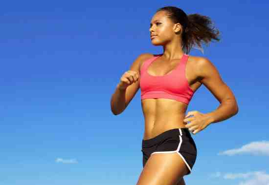 Woman running in sports bra