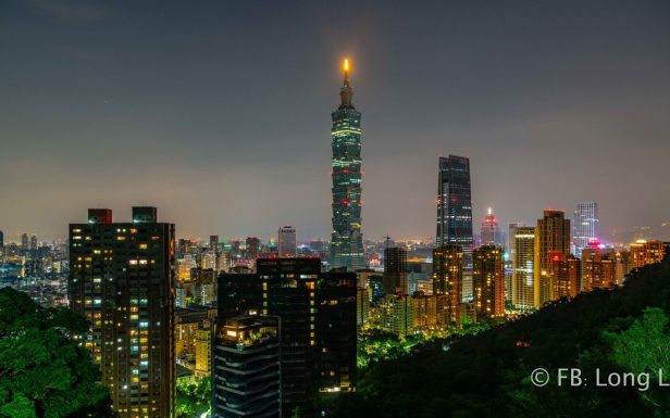 bright taipei 101 tower and city at night from xiangshan mountain