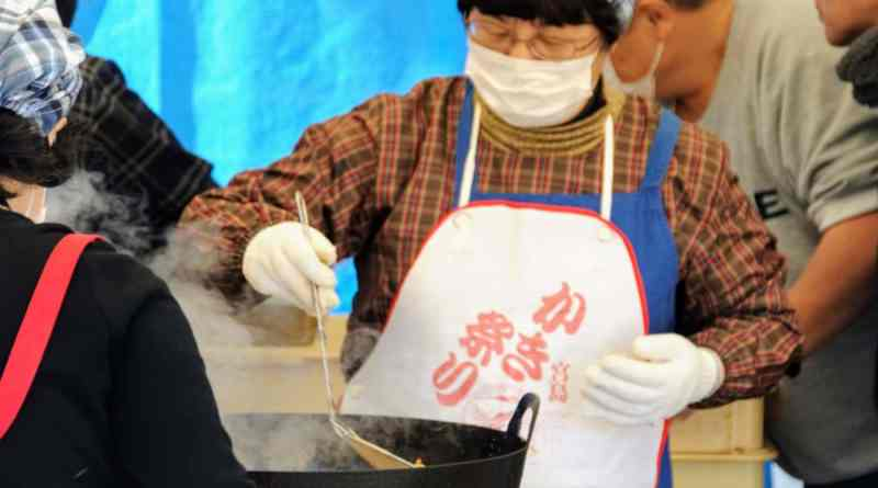 Serving up oyster stew at the Miyajima Oyster Festival.jpg